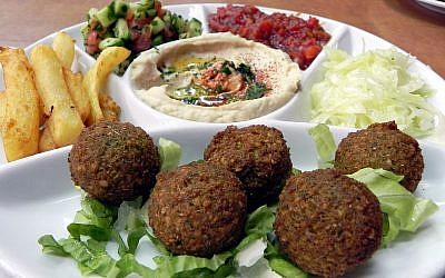 Serving in Jerusalem restaurant including falafel, hummus and Israeli salad, a typically Israeli dish. (young shanahan/Wikipedia)