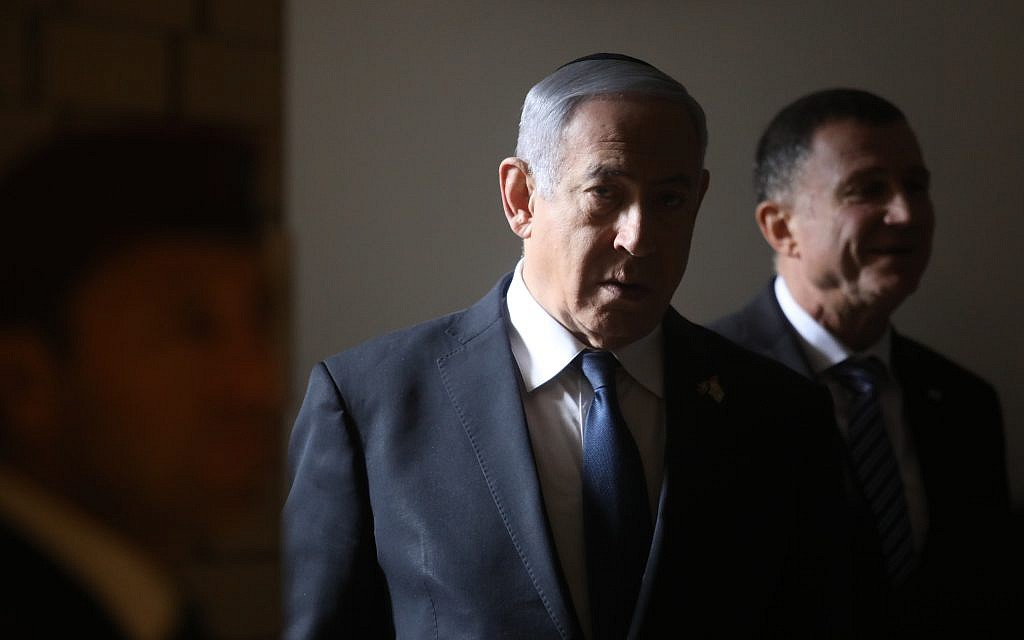 Netanyahu pre-indictment hearing in corruption cases postponed