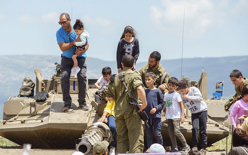 Children in an exhibit of Israeli military weapons during the celebration of the 71st Independence Day near the northern city of Kiryat Shmona, May 9, 2019. Photo by: JINIPIX