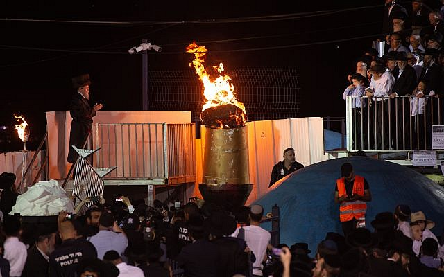 Thousands of orthodox Jews gather at the gravesite of Rabbi Shimon Bar Yochai, on Mt. Meron in Israel's northern Galillee, in traditional celebration of the Jewish Holiday of Lag Ba'omer, early Tuesday morning, May 22, 2019. Lag Ba'omer is celebrated to commemorate the day a plague ended in which thousands of students of Rabbi Akiba, a Talmudic scholar, died. This holiday is traditionally celebrated by the lighting of bonfires and festivities. Mt. Meron is the location for the central event of the evening, attracting approximately 40,000 celebrators every year. Photo By: Gil Eliyahu-JINIPIX