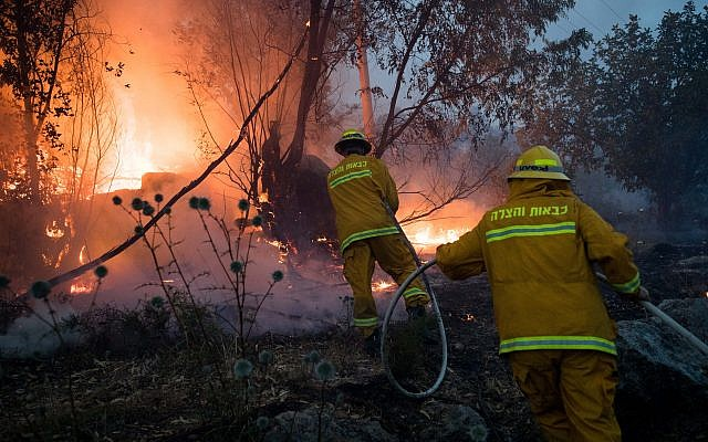 Fire fighters extinguish a forests fire near Kibbutz Harel, Thursday, May 23, 2019. Israeli police have ordered the evacuation of several communities in southern and central Israel as wildfires rage amid a major heatwave. Photo by: JINIPIX