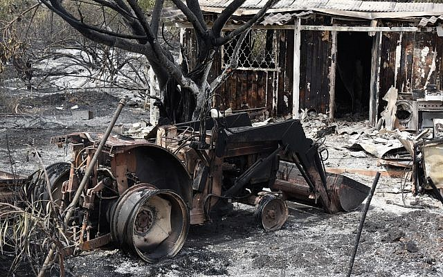 A destroyed agricultural machinery following a fire amidst extreme heat wave in the village of Mevo Modi'im, in central Israel on May 24, 2019. Photo by: JINIPIX
