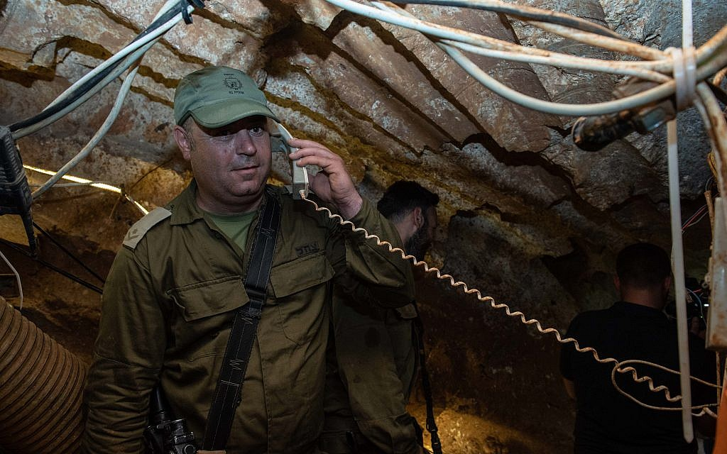 An Israeli soldier holding a telephone receiver that has been installed inside a Hezbollah tunnel that crosses from Lebanon to Israel, on the border between Israel and Lebanon in northern Israel, on May 29, 2019. Photo by: Ayal Margolin-JINIPIX