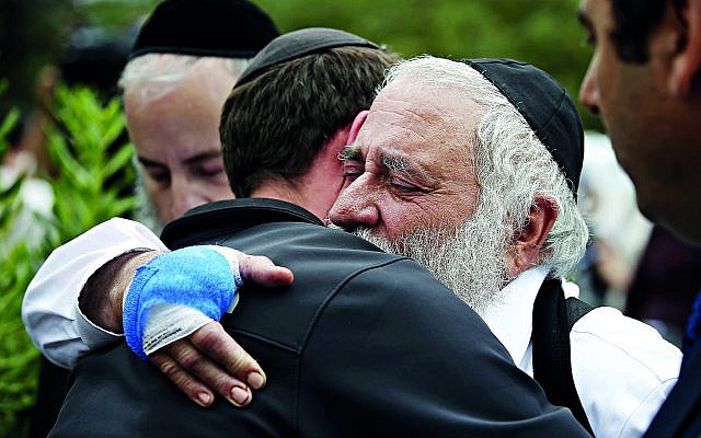 Rabbi Yisroel Goldstein hugs a member of the congregation of Chabad of Poway the day after a deadly shooting took place there, on Sunday, April 28, 2019 in Poway, Calif. (Credit Image: © TNS via ZUMA Wire)
