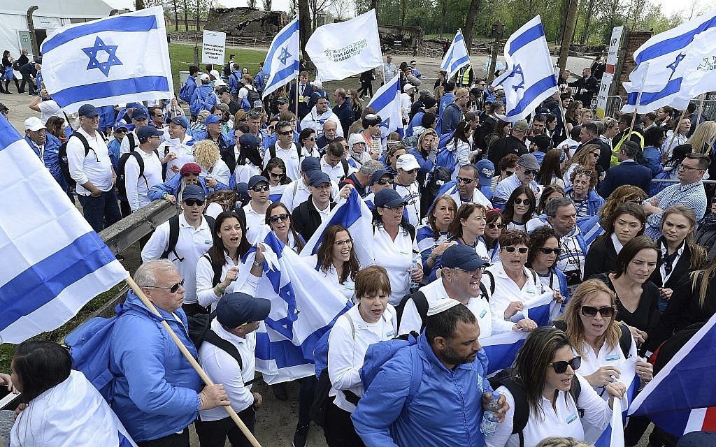 """Young Jews from around the world walk with Israeli flags through the former Nazi German death camp of Auschwitz-Birkenau during the annual Holocaust remembrance event, the """"March of the Living"""" in memory of the six million Holocaust victims in Oswiecim, Poland, Thursday, May 2, 2019. (AP Photo/Czarek Sokolowski)"""