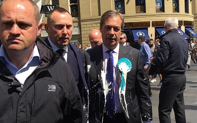 Nigel Farage after he was doused in milkshake during a campaign walkabout in Newcastle.  Photo credit: Tom Wilkinson/PA Wire