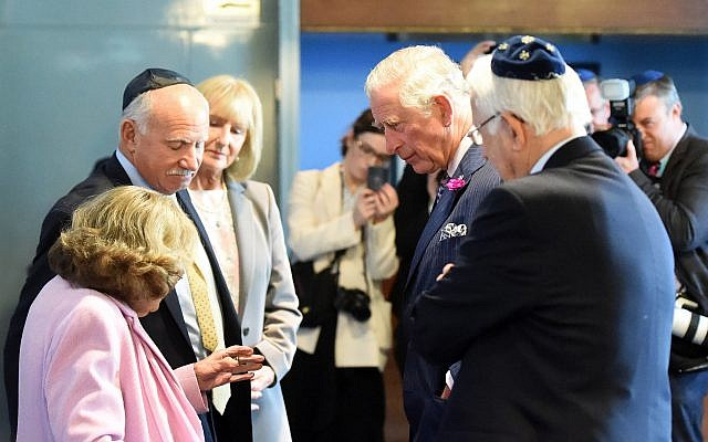 The Prince of Wales talks to Ruth Kohner, 82, who was part of the Kindertransport in 1939  during a visit to Belfast Synagogue on the second day of the Royal couple's visit to Northern Ireland.  Photo credit: Joe Giddens/PA Wire