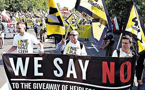 . Thousands of Polish nationalists marched to the U.S. Embassy in Warsaw, protesting that the U.S. is putting pressure on Poland to compensate Jews whose families lost property during the Holocaust.  (AP Photo/Czarek Sokolowski)