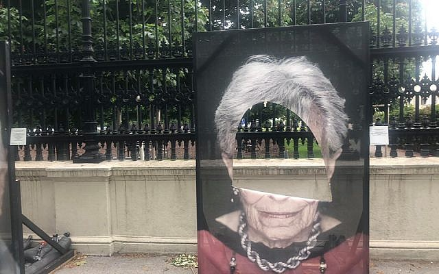 Holocaust survivor portraits have holes cut into them. Credit:  Luigi Toscano on Facebook