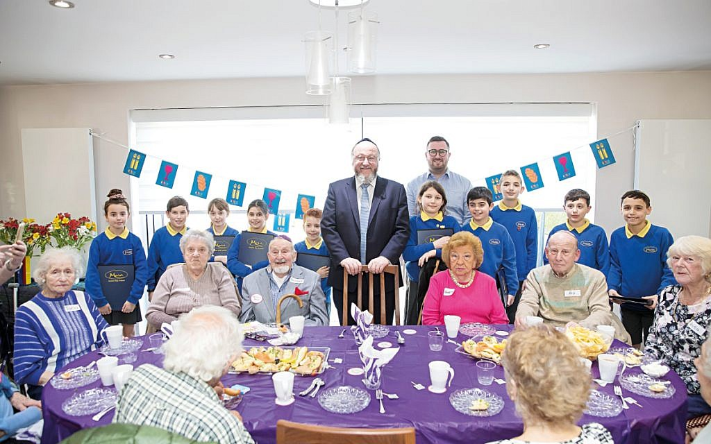 Jewish Care volunteers opening their home to Chief Rabbi Ephraim Mirvis and pupils from Moriah school earlier this year.