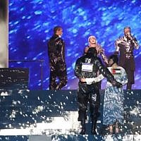 Screenshot from video of Madonna's performance, with a Palestine flag visible