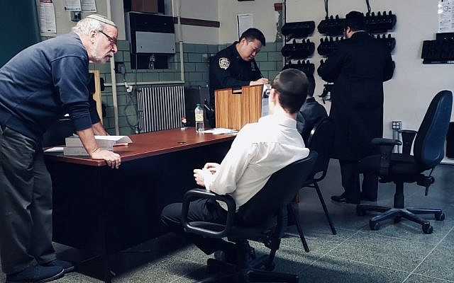 Chasidic teens in a police office being interviewed after reporting antisemitic abuse.  Credit: Dov Hikind on Twitter
