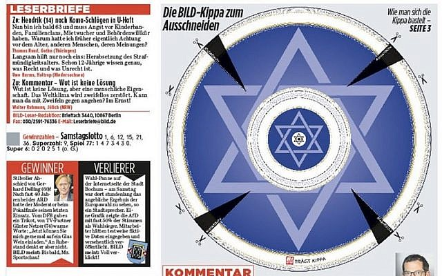 The May 27, 2019 front page of German daily Bild, featuring a cut-out kippah and urging readers to wear the Jewish kippa in protest of antisemitic attacks. (Twitter via Times of Israel)