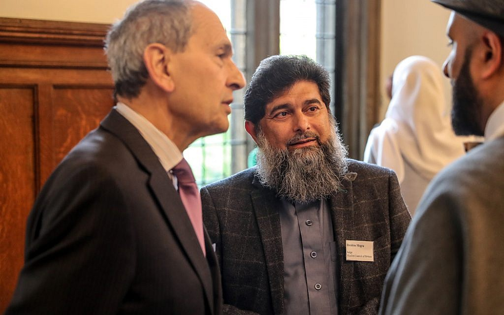 Sir Bernard Rix of Coexist House (left) speaking with Ibrahim Mogra and  (Marc Morris Photography)