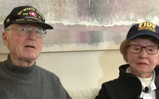 """Sophie Tajch Klisman, 89, greeted Doug Harvey, now 95, with a hug and thanked the 95-year-old for taking part in the liberation of the Salzwedel camp, telling him: """"You gave me my life"""". (Screenshot from video - clickondetroit.com)"""