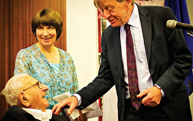 Lord Alf Dubs (right) meets with Sir Nichols Winton and his daughter Barbara in 2014.