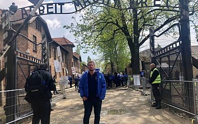 Noam Mirvis at the infamous gates of Auschwitz