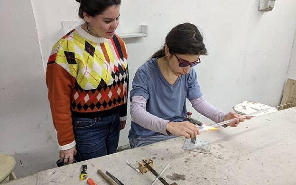 """Shi Lowidt, a second year Ceramics and Glass Design student at Bezalel Academy of Arts and Design Jerusalem, works with Linda Meripeled, a student at The Gerrit Rietveld Academie in Amsterdam, on an """"alternative mezuzah"""" during Bezalel Academy's International Week program."""