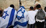 Jewish men pray at the Western Wall in Jerusalem Old City during Yom Yerushalayim (Jerusalem Day), June 2, 2019. Photo by: JINIPIX