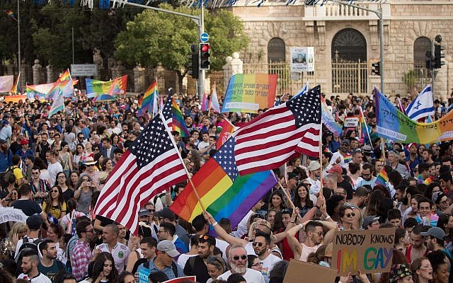 "Members and sympathizers of the LGBTI (lesbian, gay, bisexual, transgender, and intersex) community participate in the annual Gay Pride parade in Jerusalem, Israel, 06 June 2019. Under heavy police security, thousands of people marched at the 18th Jerusalem March for pride and tolerance, this year's parade theme is ""One Community - Many Faces"" as marchers call for equality, security and freedom for the LGBT community. Photo by: JINIPIX"