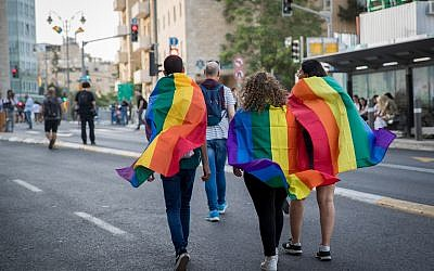 """Members and sympathizers of the LGBTI (lesbian, gay, bisexual, transgender, and intersex) community participate in the annual Gay Pride parade in Jerusalem, Israel, 06 June 2019. Under heavy police security, thousands of people marched at the 18th Jerusalem March for pride and tolerance, this year's parade theme is """"One Community - Many Faces"""" as marchers call for equality, security and freedom for the LGBT community. Photo by: JINIPIX"""