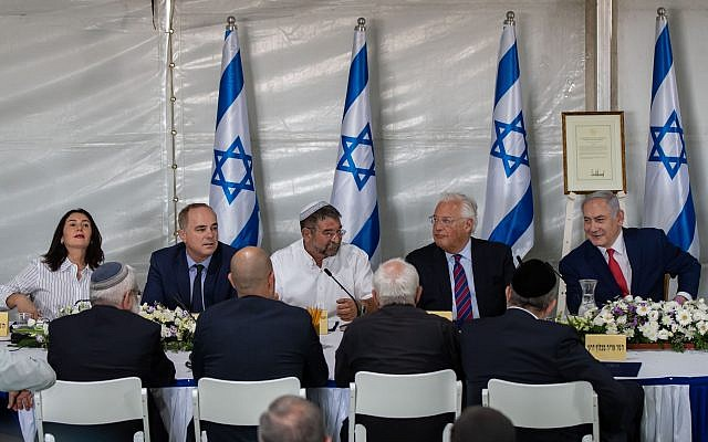 Israeli Prime Minister Benjamin Netanyahu (R) and the US ambassador Dived Friedman (L) , attending a special festive cabinet meeting at the Israeli settlement of Bruchim-Kela Alon, in the Golan Heights, 16 June 2019. The festive cabinet held in Bruchim-Kela Alon is expected to approve Netanyahu decision to build a new settlement in the Golan Heights which is to be named after US President Trump over his unilateral recognition of Israeli sovereignty over the Golan Heights. Israel takeover the Golan Heights during the six days war between Israel and Syria in 1967, and annexed to Israel in 1981. Photo by: Ayal Margolin-JINIPIX