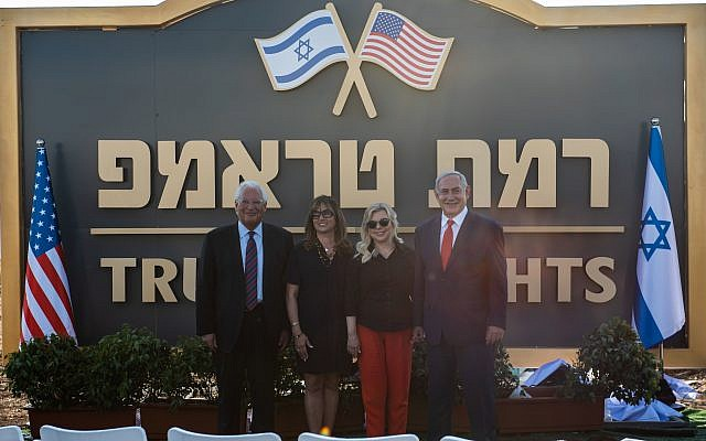 US Ambassador to Israel David Friedman (L) and his wife Tammy (2-L) and the Israeli Prime Minister Benjamin Netanyahu (R) and his wife Sara (2-R) during the unveiling of the sign of the new settlement that approved by the Israeli cabinet earlier today and will be called 'Trump Heights', during an official ceremony in Bruchim-Kela Alon Golan Heights, 16 June 2019. After a festive cabinet that held in Bruchim-Kela Alon , Netanyahu cabinet approved the building of a new settlement in the Golan Heights which is to be named after US President Trump over his unilateral recognition of Israeli sovereignty over the Golan Heights. Israel takeover the Golan Heights during the six days war between Israel and Syria in 1967, and annexed to Israel in 1981. Photo by: Ayal Margolin-JINIPIX
