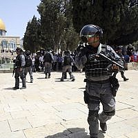 Israeli police officers take positions during clashes with Palestinians by the Dome of the Rock Mosque in the Al Aqsa Mosque compound in Jerusalem's old city, Sunday, June 2, 2019. (AP Photo/Mahmoud Illean)