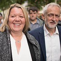 Labour Party leader Jeremy Corbyn celebrates with newly elected labour MP Lisa Forbes (Photo credit: Stefan Rousseau/PA Wire)