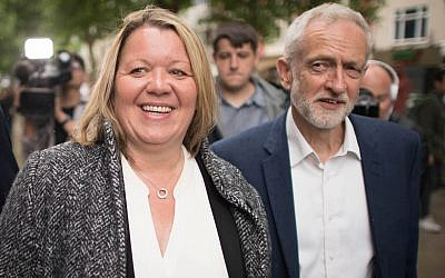 Labour Party leader Jeremy Corbyn celebrates with newly elected labour MP Lisa Forbes at Cathedral Square, Peterborough following her victory in the Peterborough by-election.. Photo credit: Stefan Rousseau/PA Wire
