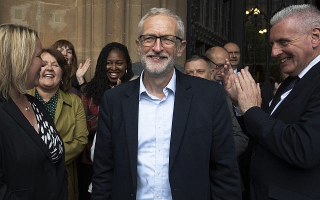 Labour Leader Jeremy Corbyn (centre) celebrates with the Shadow Cabinet and Labour MPs as they welcome newly-elected Labour Member of Parliament Lisa Forbes (left) to Parliament in Westminster (Photo credit: Victoria Jones/PA Wire)
