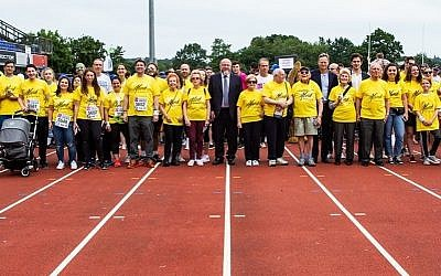 Survivors, surrounded by friends and family, and Chief Rabbi Ephraim Mirvis at last year's Maccabi GB Community Fun Run   (Credit: Blake Ezra Photography)