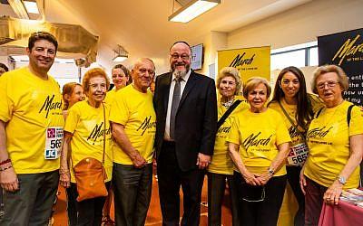 Left to Right are: Scott Saunders (Chairman, March of the Living UK), Eve Kugler, Arek Hersh, Chief Rabbi, Jean Hersh, Mala Tribich, Cassie Matus (CEO, March of the Living UK), Agnes Kaposki. (Blake Ezra Photography)