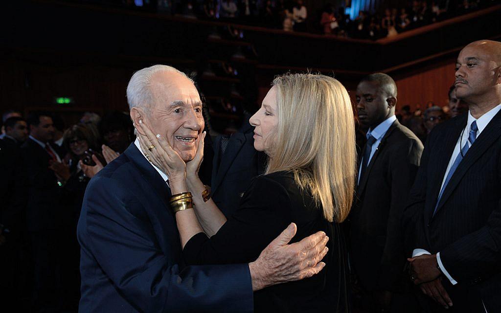 Singer Barbra Streisand hugs late Israeli President Shimon Peres   (Photo by Kobi Gideon/GPO via Getty Images)