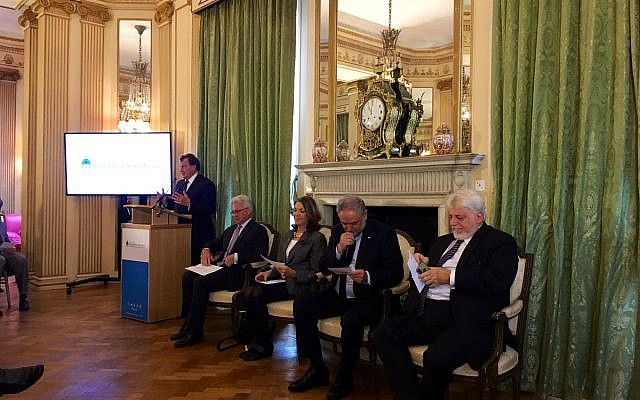 Sir Alan Duncan MP (second from left) at the Argentinian Embassy in London's event to remember the Jewish centre bombing, as  Argentinian Ambassador Carlos Sersale di Cerisano addresses guests.