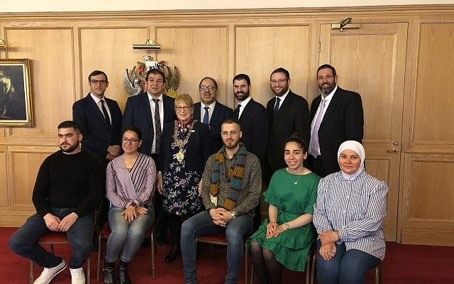 United Synagogue rabbis David Mason, Nicky Liss, Marc Levene, Yoni Birnbaum, Ephraim Guttentag, and Sam Taylor, with refugees Alyaa, Hafssa, Martin, Ahmad and Sara