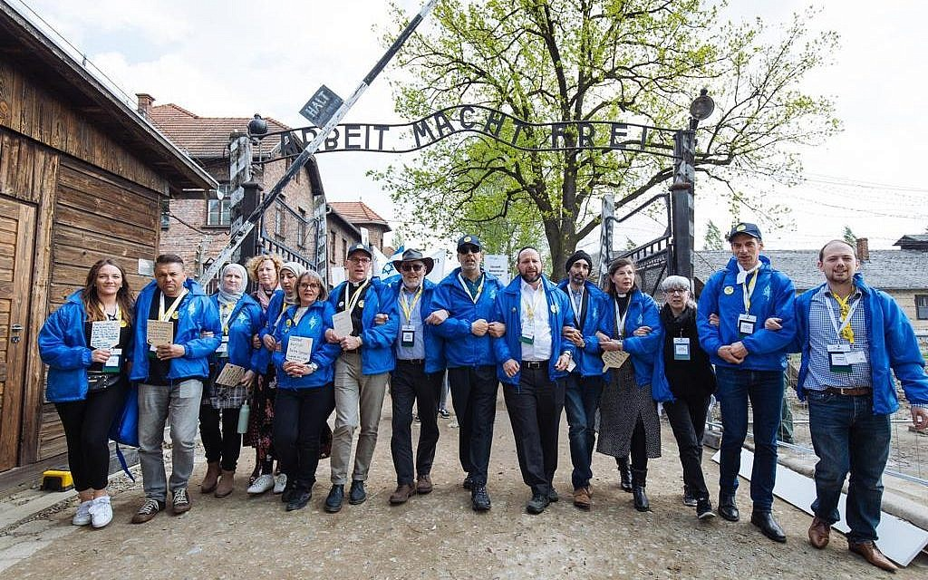 March of the Living group at Auschwitz notorious gate. Credit: Sam Churchill Photography via Jewish News