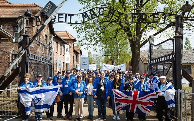 March of the Living delegation at the gates of Auschwitz in April, featuring some of the survivors and participants to take part in the Maccabi GB Community Fun Run  Photo credit: Sam Churchill