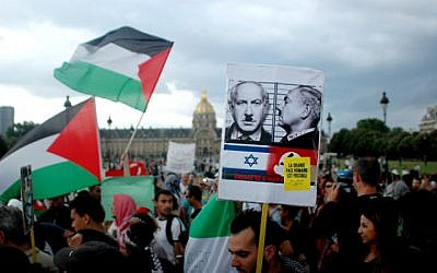 Protesters wave Palestinian flags and hold placards during a pro-Palestinian demonstration in Paris, France, on August 2, 2014. Israel bombarded Gaza on Saturdayafter accusing Hamas of destroying a humanitarian ceasefire by capturing a soldier whom the Islamists say was probably killed in Israeli shelling. Photo by Alain Apaydin/ABACAPRESS.COM