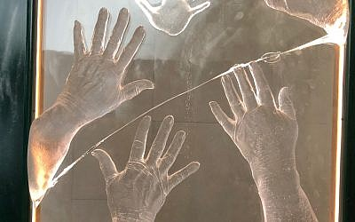 Smashed train window with handprints.  Credit Robert Tait for the Guardian