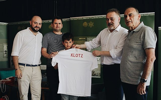 Left to Right Director of From The Depths Jonny Daniels, Yoav and Eitan Dekel, Director of the the Polish Football association PZPN Janusz Basalajand Mr. Avram Grant. . (photo credit: From the Depths)