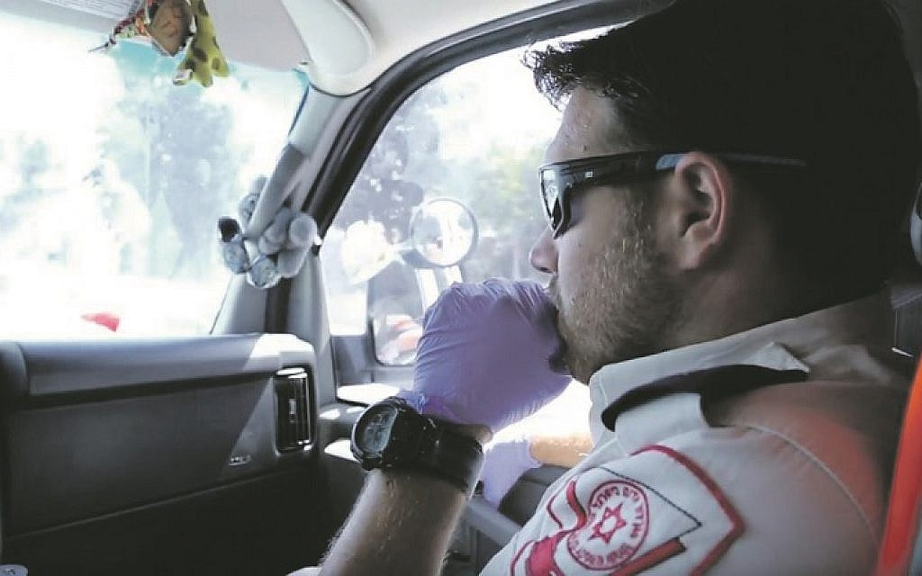 Magen David Adom medic on his way to an emergency in East Jerusalem