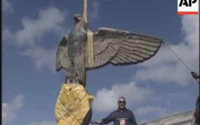 Screenshot from video, showing Nazi eagle after being salvaged. (https://www.youtube.com/watch?v=2ZH5Sot5hic)