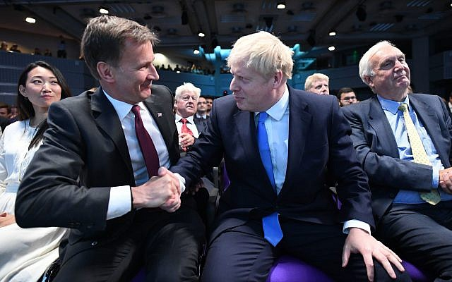 Jeremy Hunt (second left) congratulates Boris Johnson (second right) after he is announced as the new Conservative party leader. Photo credit: Stefan Rousseau/P/A Wire