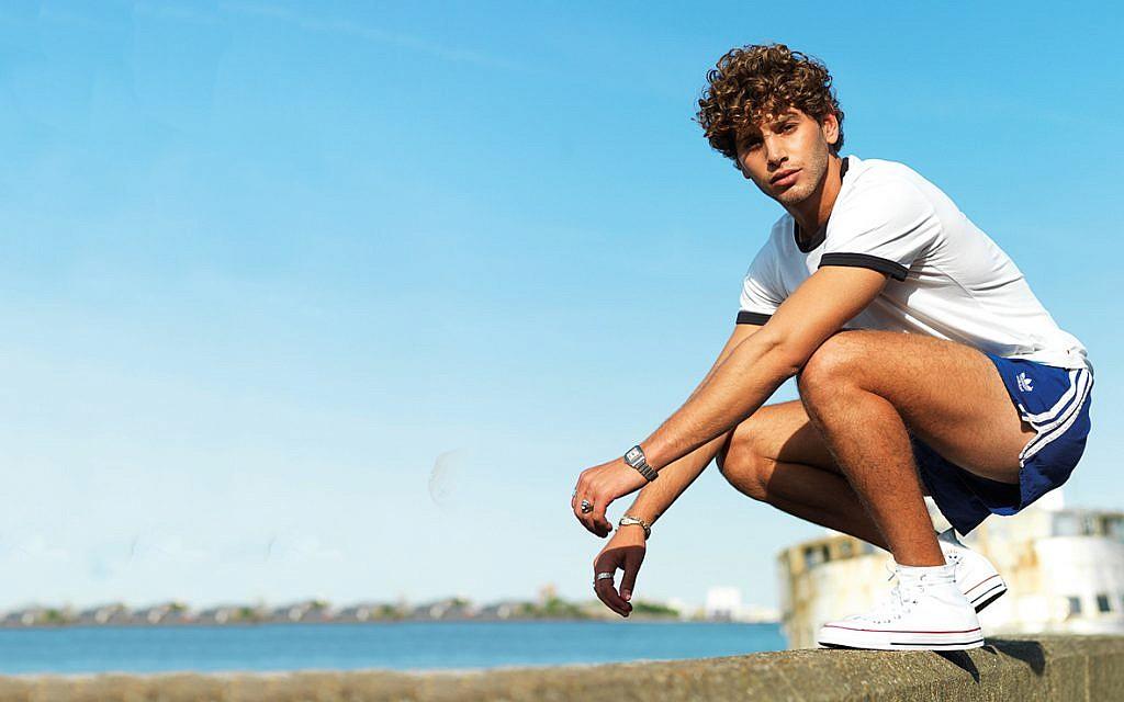 Love Island's Eyal Booker on holidays as a kid, FZY tour and perfect beach hair!