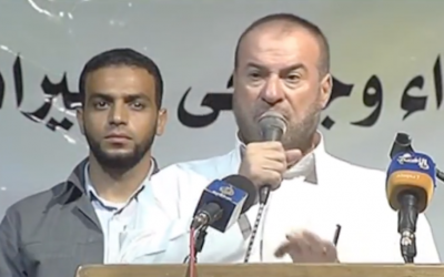 Fathi Hammad, right, was a Hamas cabinet member until 2014. (Screenshot from YouTube)