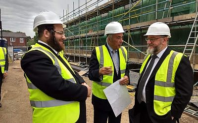 Benjamin Perl (centre) and the Chief Rabbi with Rabbi Tuvia Freund from Israel at the site of the new school building.