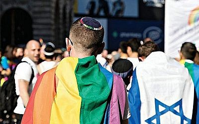 Keshet UK Pride picture from 2017, with a Jewish member of the march wearing a kippah, alongside another with an Israel flag. (Jewish News)