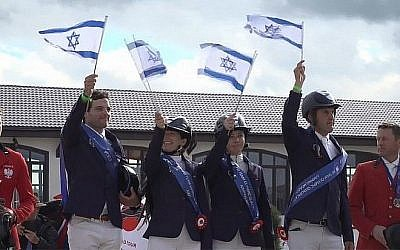Screen capture from video of Team Israel show jumpers after winning the Olympic Jumping Qualifier at Maxima Park in Moscow, June 30, 2019. (YouTube via Times of Israel)