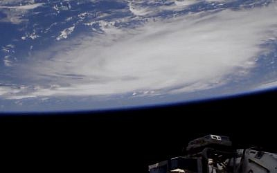 This Thursday, Aug. 29, 2019 image provided by NASA shows a view of Hurricane Dorian from the International Space Station as it churned over the Atlantic Ocean north of Puerto Rico.     (NASA via AP)